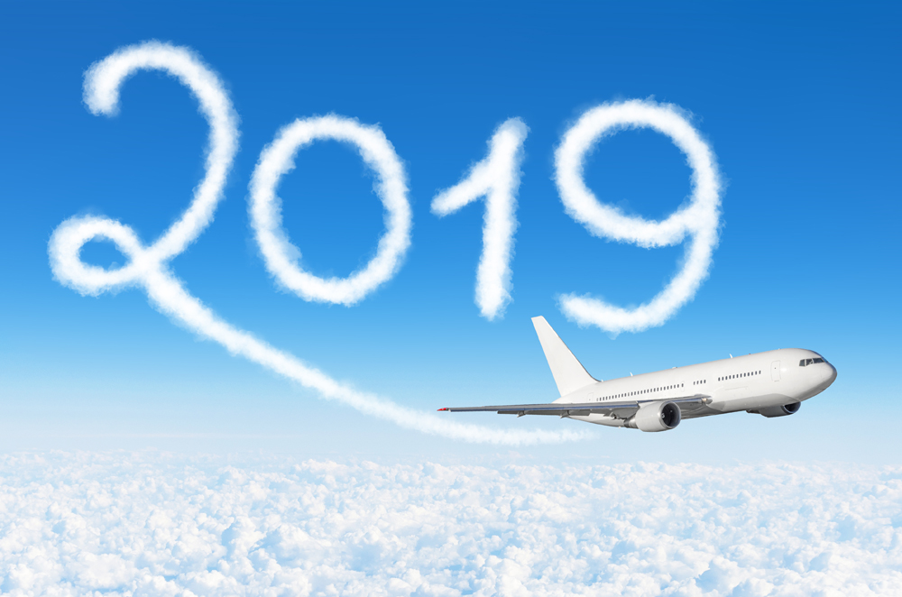 2019 cloud with plane in sky