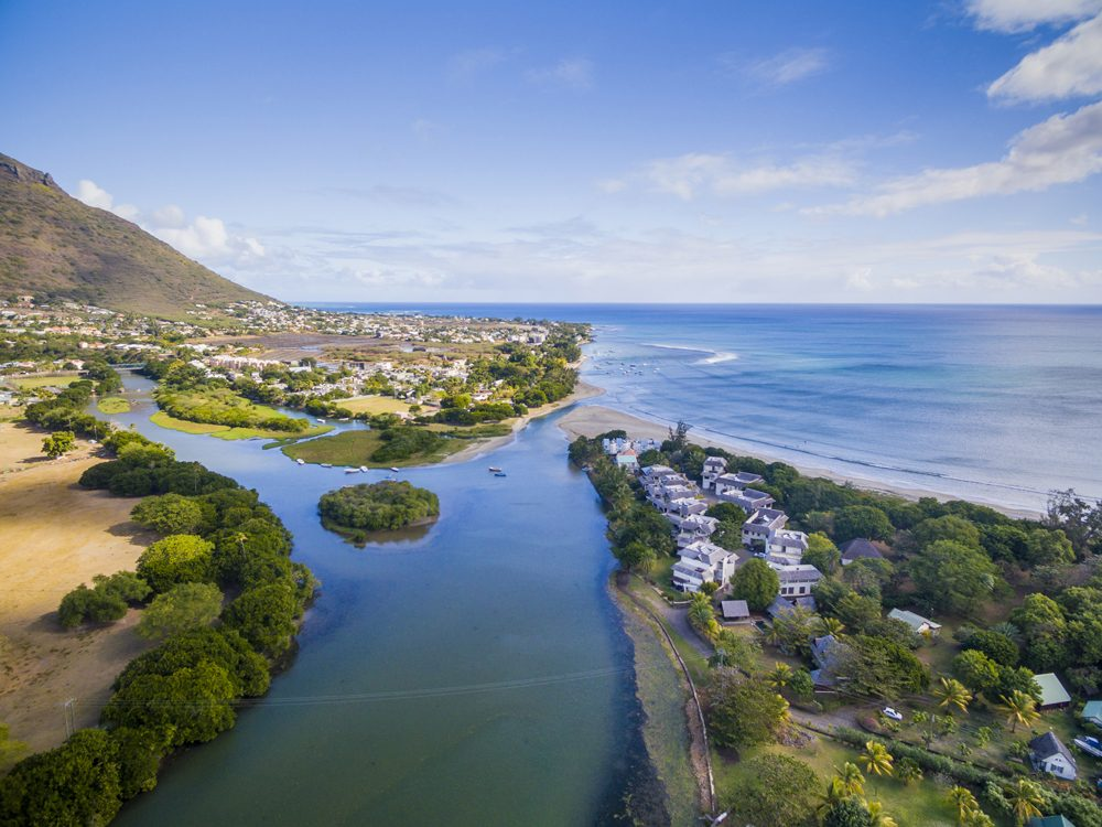 Aerial view of Black River Tamarin Beach with Black River Gorge National Park in background, Mauritius