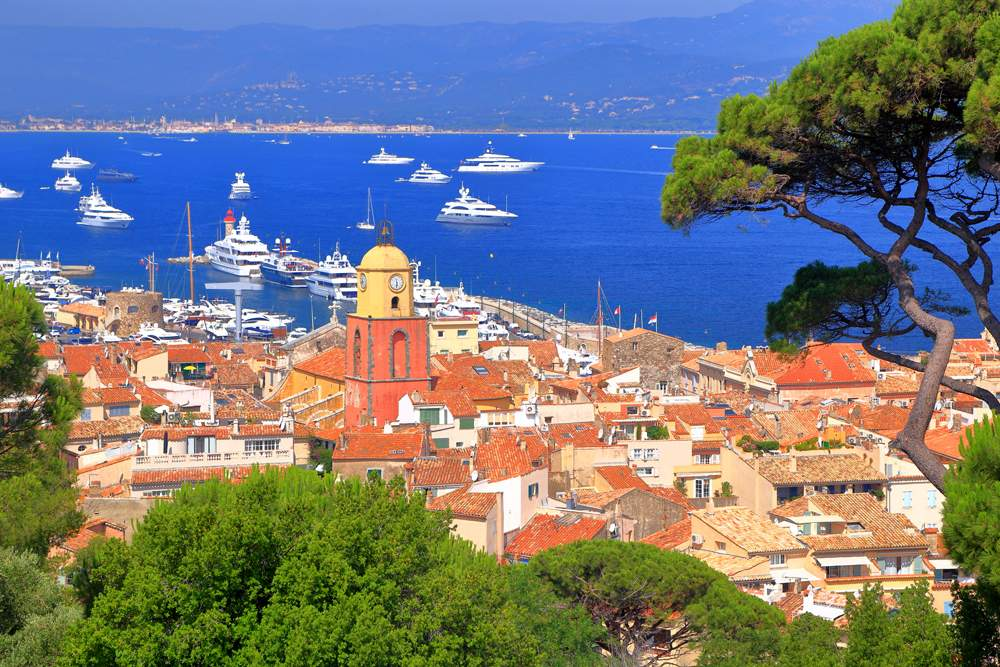 Aerial view to the old town and distant boats in Saint Tropez, France