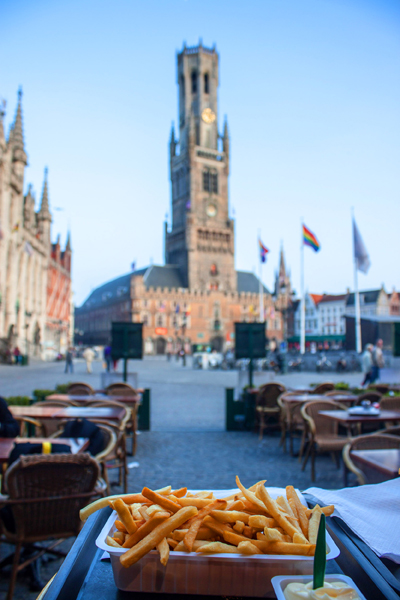 Fries with Bell Tower and Market Square in background, Bruges, Belgium