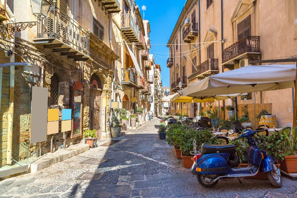 Narrow street in the old town of Cefalu in Sicily, Italy