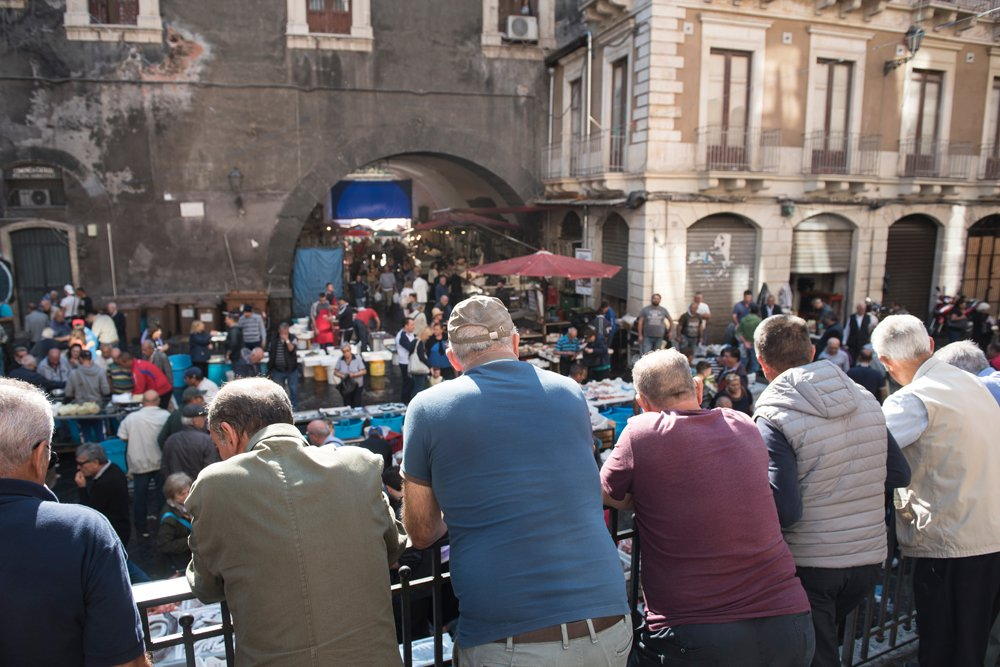 Overlooking the bustle at the Fish Market in Catania, Sicily, Italy