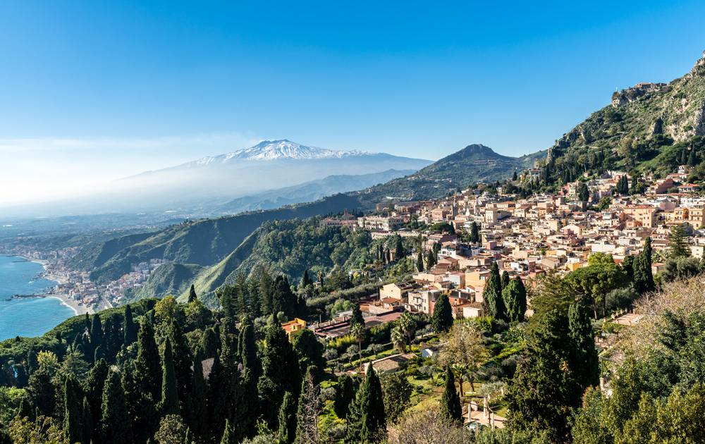 Panoramic view from Teatro Greco of Taormina, Giardini Naxos and Mount Etna in Sicily, Italy