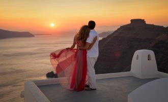 Silhouette of a loving couple in Santorini at sunset, Greece