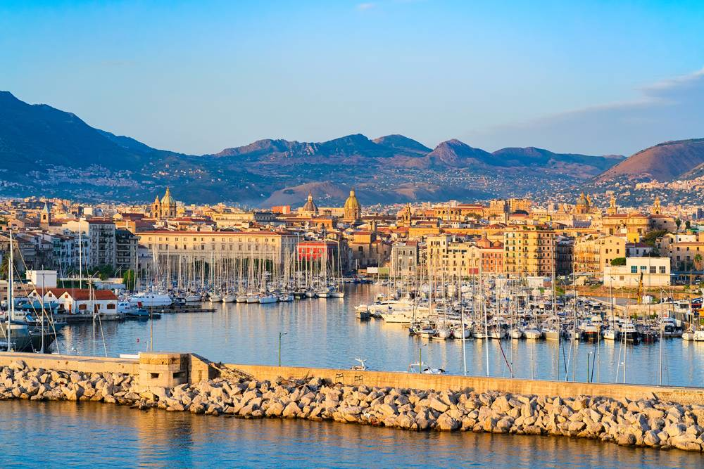 Sunrise on the Mediterranean sea and port of Palermo old city, Sicily, Italy
