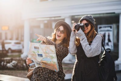 Happy female friends on travel together
