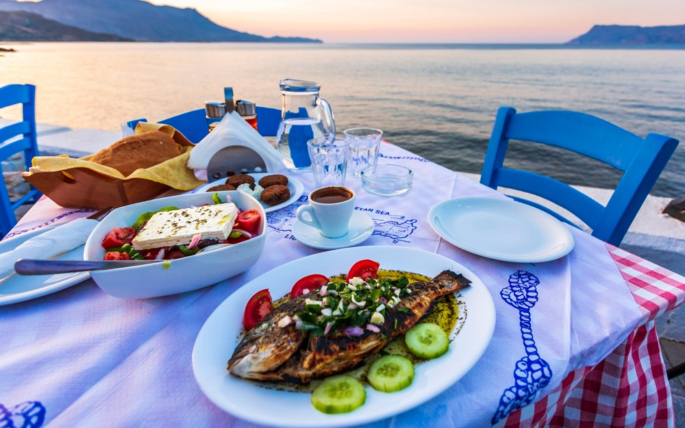Traditional Cretan Dorada fish with Greek salad, Kissamos, Crete, Greece
