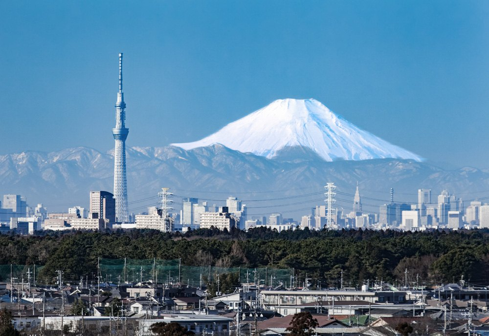 Downtown Tokyo with Sky Tree and Mount Fuji in background, Japan