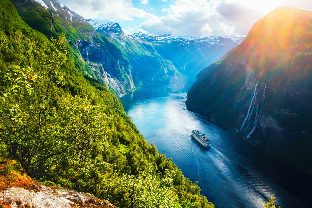 Sunnylvsfjorden Fjord with cruise ship and famous Seven Sisters waterfalls, near Geiranger village, Norway