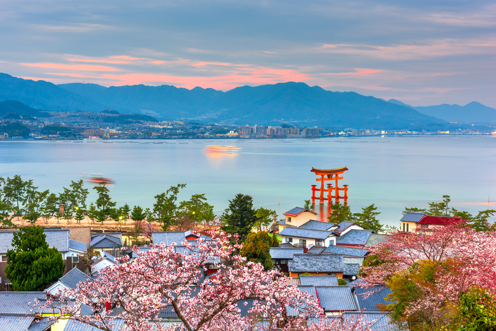 Temples on the Seto Inland Sea at dusk in the spring season, Miyajima Island, Hiroshima, Japan