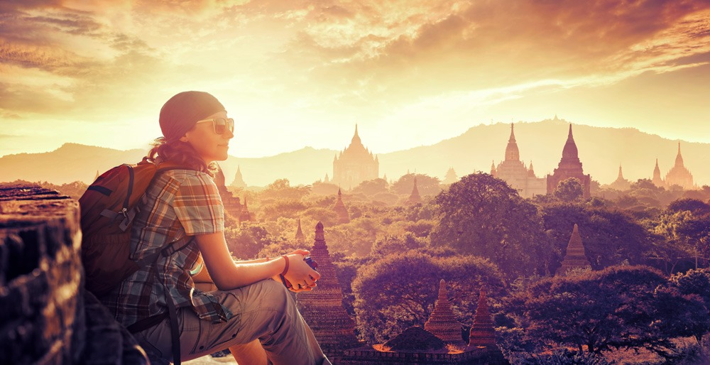 Young backpacker enjoying the view at sunset in Bagan, Myanmar