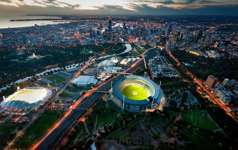 Aerial view of Melbourne skyline at dusk with Melbourne Cricket Stadium and grounds, Victoria, Australia