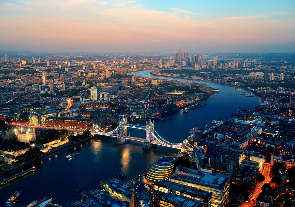 Aerial view of Tower Bridge and Thames River at sunset, London, England, UK