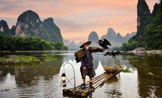 Fisherman of Guilin, Li River and Karst mountains during the blue hour of dawn, China