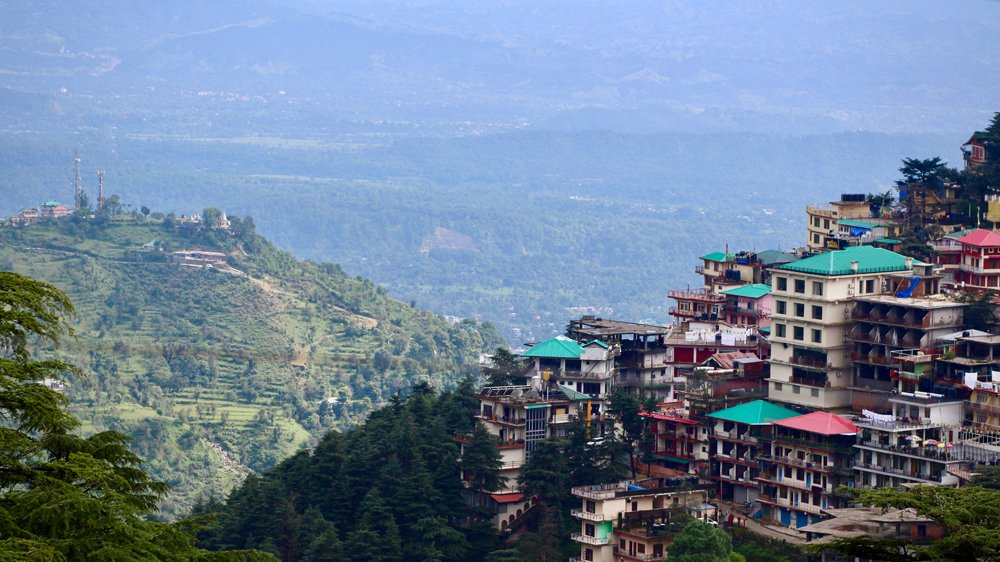Kangra Valley and mountain homes from Upper Dharamshala on a sunny summer day, India