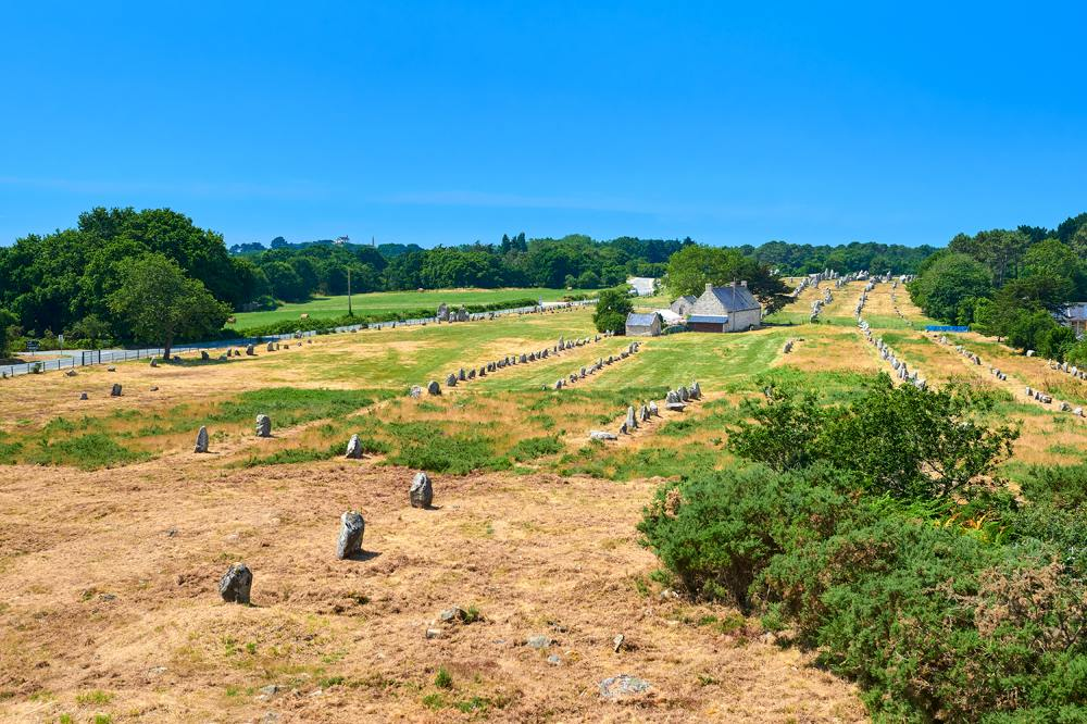 Megalithic alignment of standing stones in the Neolithic prehistoric site of Carnac, Brittany, France