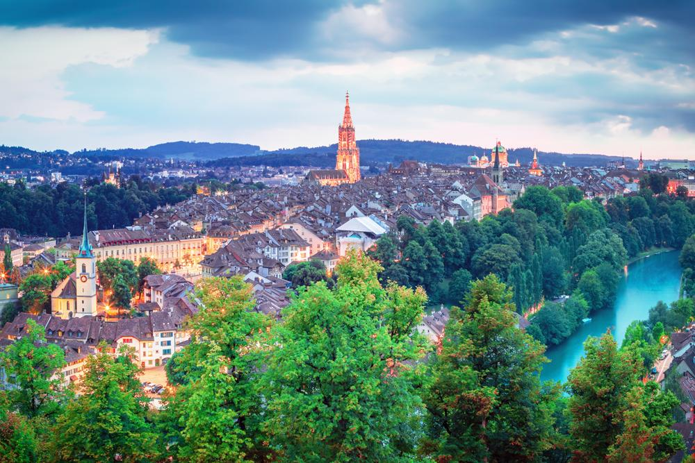 Old Town of Bern and lit up Munster Cathedral at sunrise, Switzerland
