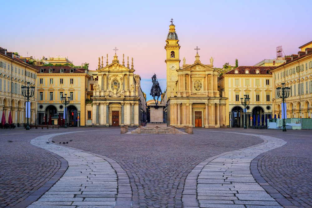 Piazza San Carlo square at sunrise with twin churches of Santa Cristina and San Carlo Borromeo in the Old Town centre of Turin, Italy