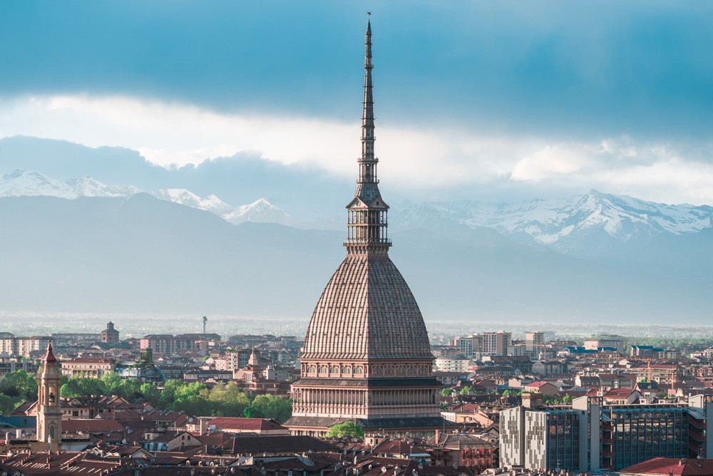 Sunset view of Turin with a close-up of Mole Antonelliana towering the city, Italy