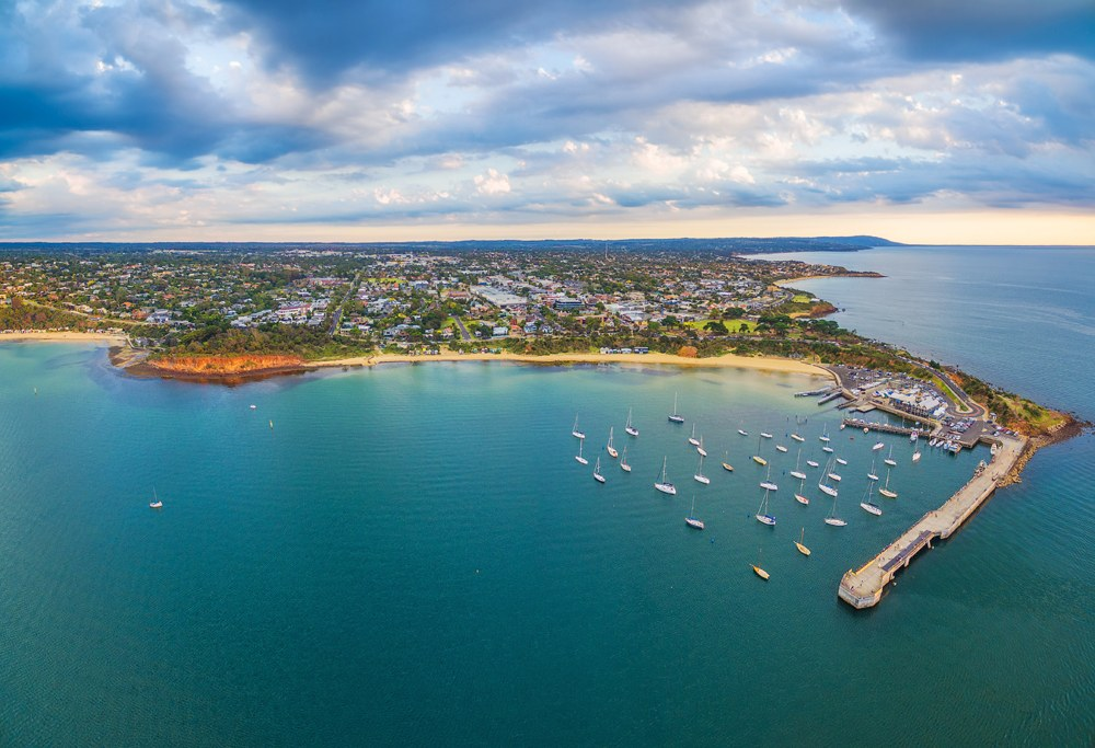 Aerial panorama of Mornington Peninsula coastline and Mornington Pier at sunset, Melbourne, Victoria, Australia