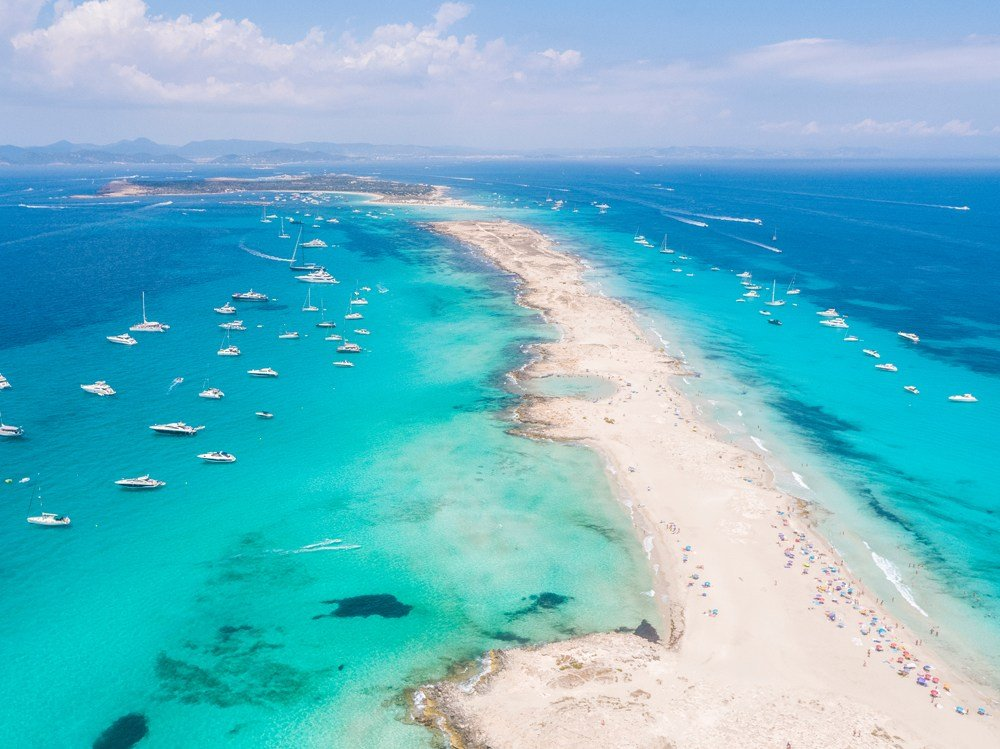 Aerial view over the clear beach and turquoise water of Formentera, Balearic Islands, Spain
