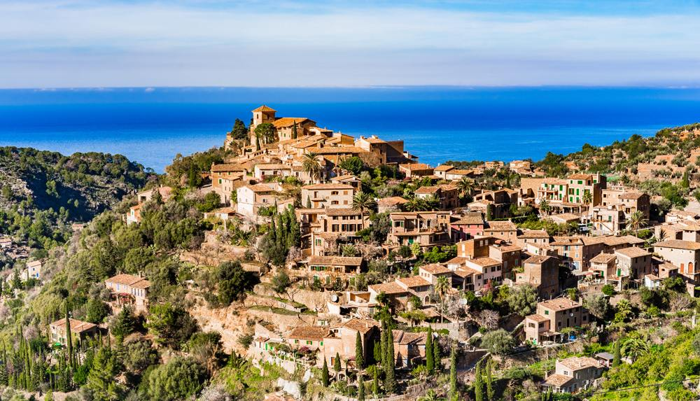Beautiful view of the old Mediterranean mountain village of Deia, Majorca, Balearic Islands, Spain