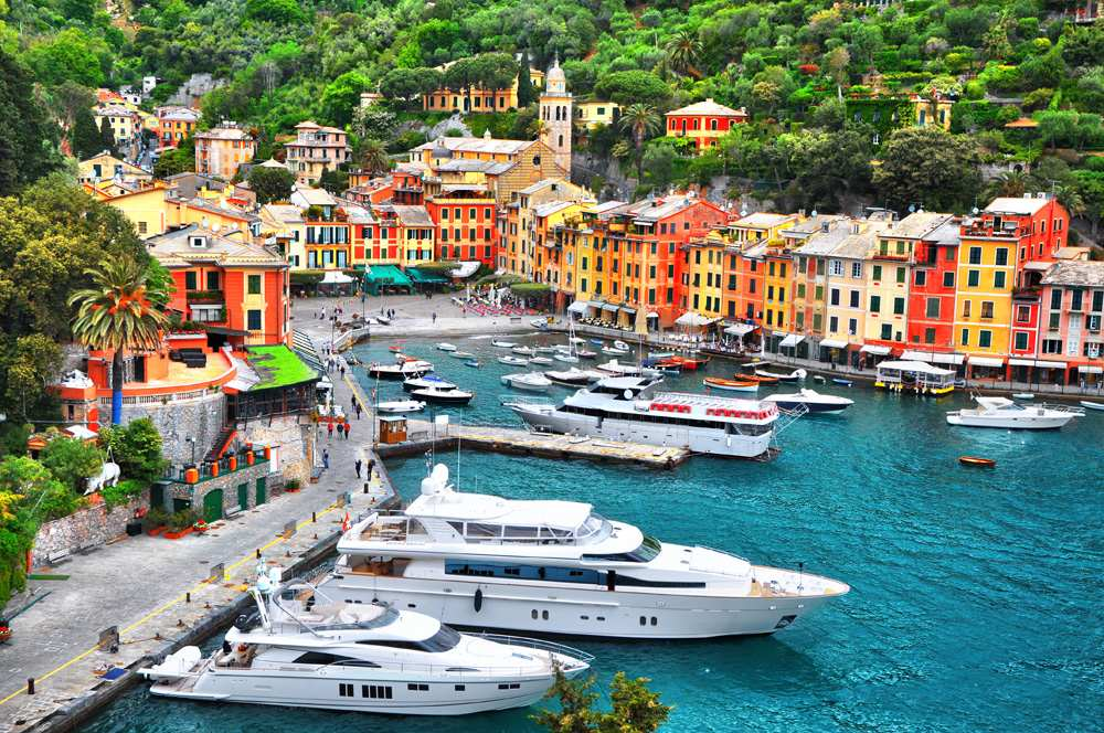 Colourful houses and villas, luxury yachts and boats in Portofino, Liguria, Italy