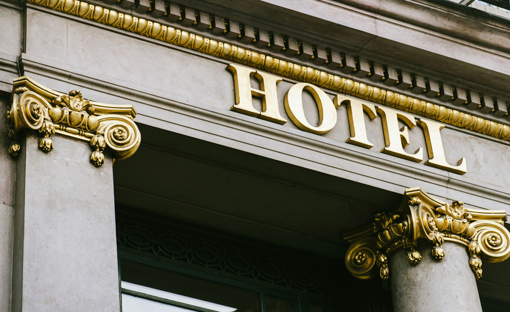 Hotel word with golden letters on luxury hotel with beautiful columns