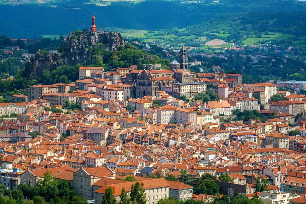 Panoramic view of red tiled roofs of Le Puy-en-Velay, Auvergne, France