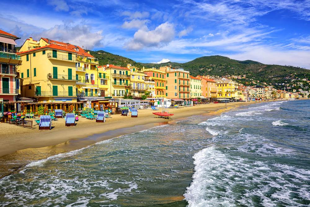 Sandy beach in town of Alassio, Liguria, Italy