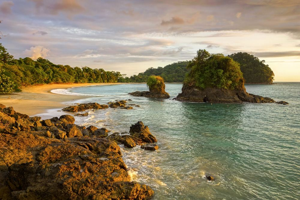 Sunset view and dramatic landscape of Espadilla Beach in Manuel Antonio National Park, Costa Rica