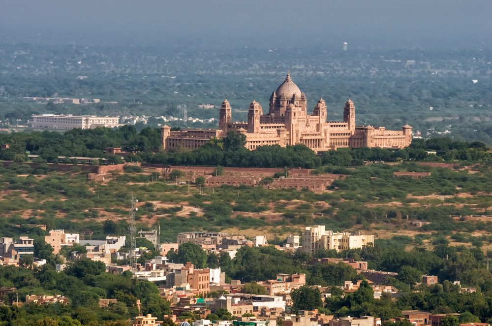 View of the blue city of Jodhpur and Umaid Bhawan Palace, India