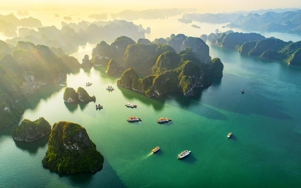 Aerial view of floating fishing village and rock island, Halong Bay, Vietnam