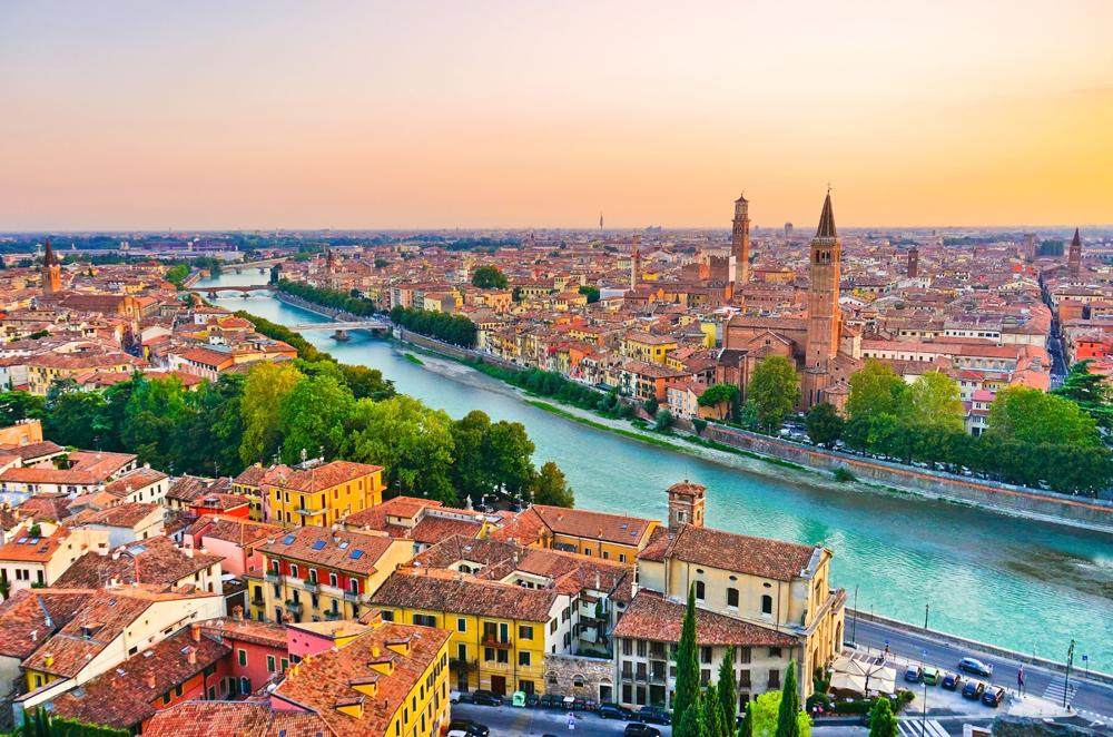 Aerial view of the historic city centre along Adige river at sunset in Verona, Italy