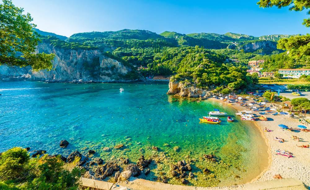 Beautiful beach and boat in Paleokastritsa, Corfu island, Ionian Islands, Greece