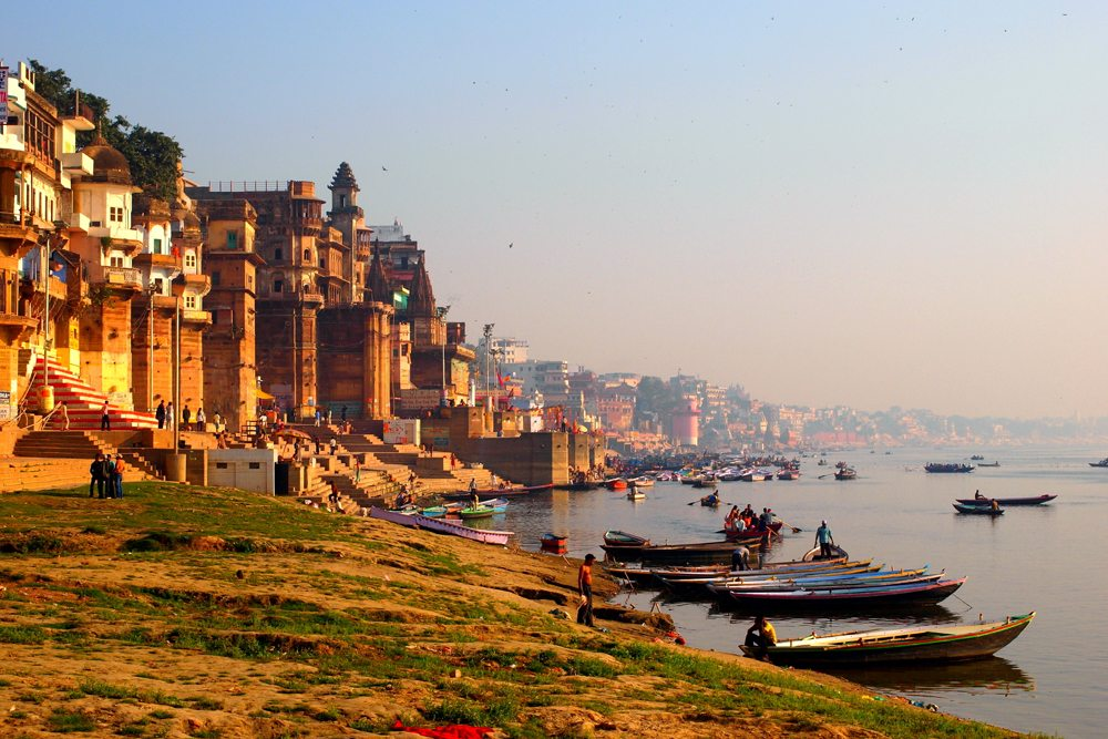 Boats on the Ganges River along a shoreline of ghats, Varanasi, India