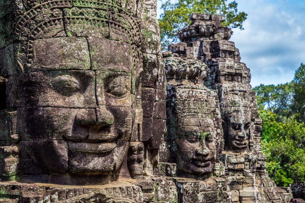 Buddhist faces on towers at Bayon Temple, Angkor Wat temple complex, Siem Reap, Cambodia