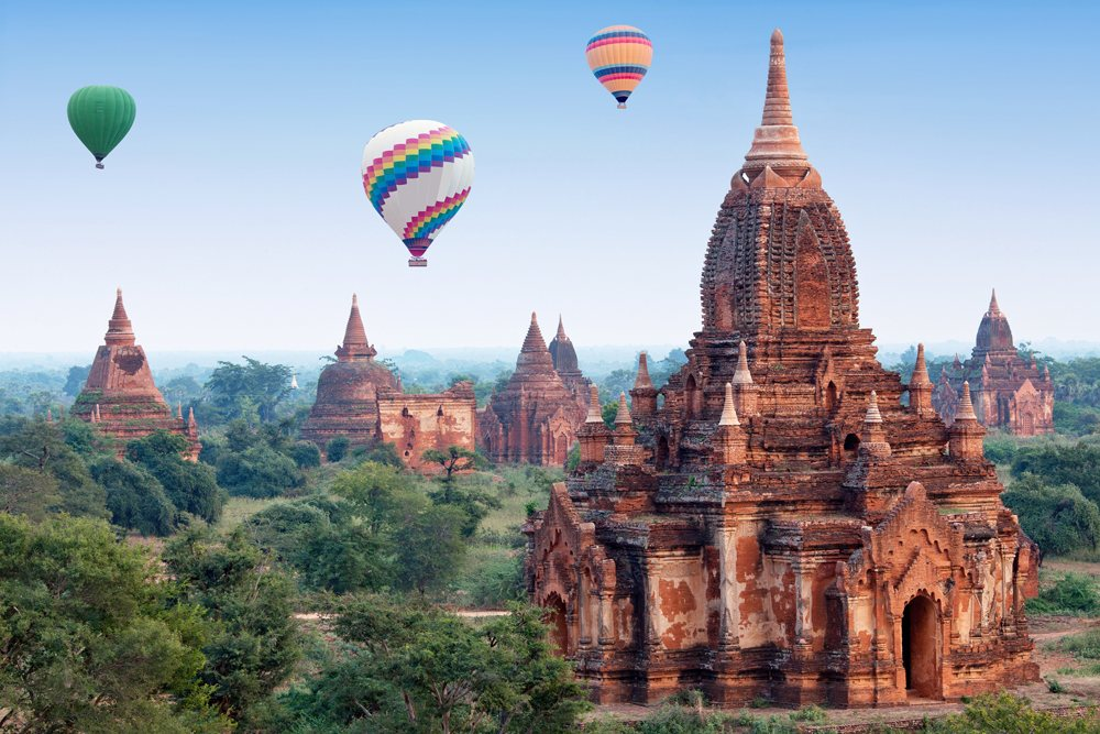 Colourful hot air balloons flying over Bagan Archaeological zone, Myanmar