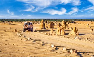 Pinnacles rock park with 4x4, Nambung National Park, Cervantes, Western Australia, Australia - cropped