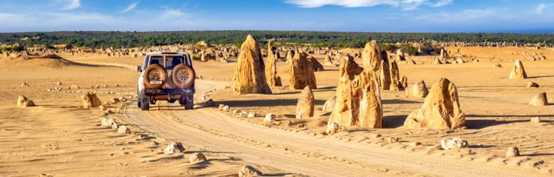 Pinnacles rock park with 4x4, Nambung National Park, Cervantes, Western Australia, Australia - cropped