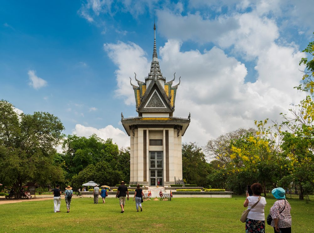 Tourists visiting the skull pagoda in the Killing Fields, Phnom Penh, Cambodia