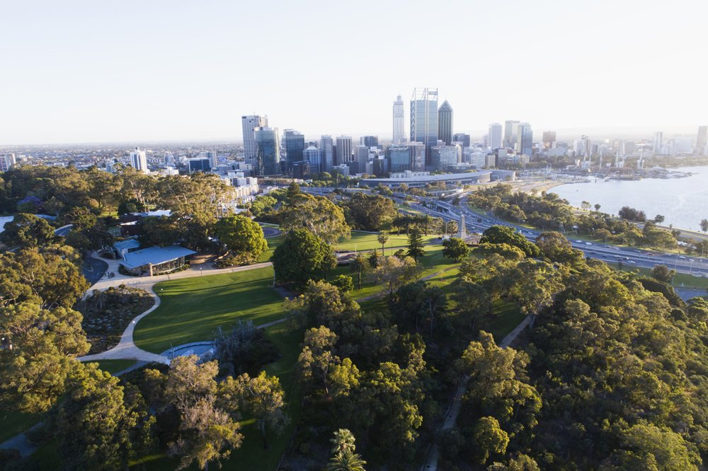 Aerial view of Kings Park and Botanical Garden with Perth City skyline in the background. Australia - Tourism Western Australia