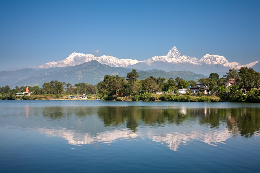 View of Annapurna mountain range and its reflection in Phewa Lake in Pokhara, Nepal