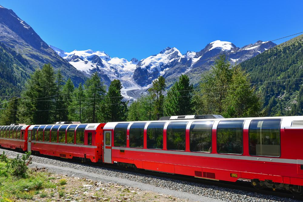 Bernina Express crossing the Alps with glaciers in the background, Switzerland