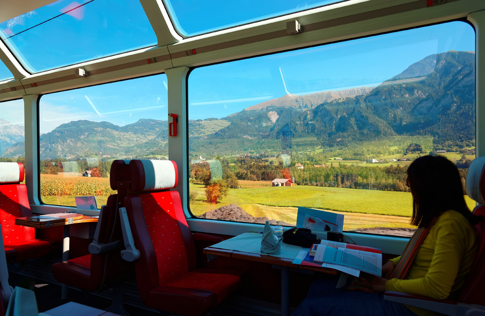Enjoy Swiss countryside scenery through the panoramic windows on the Glacier Express, Switzerland