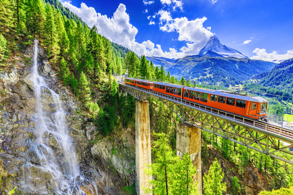 Gornergrat tourist train with waterfall, bridge and Matterhorn, Zermatt, Switzerland
