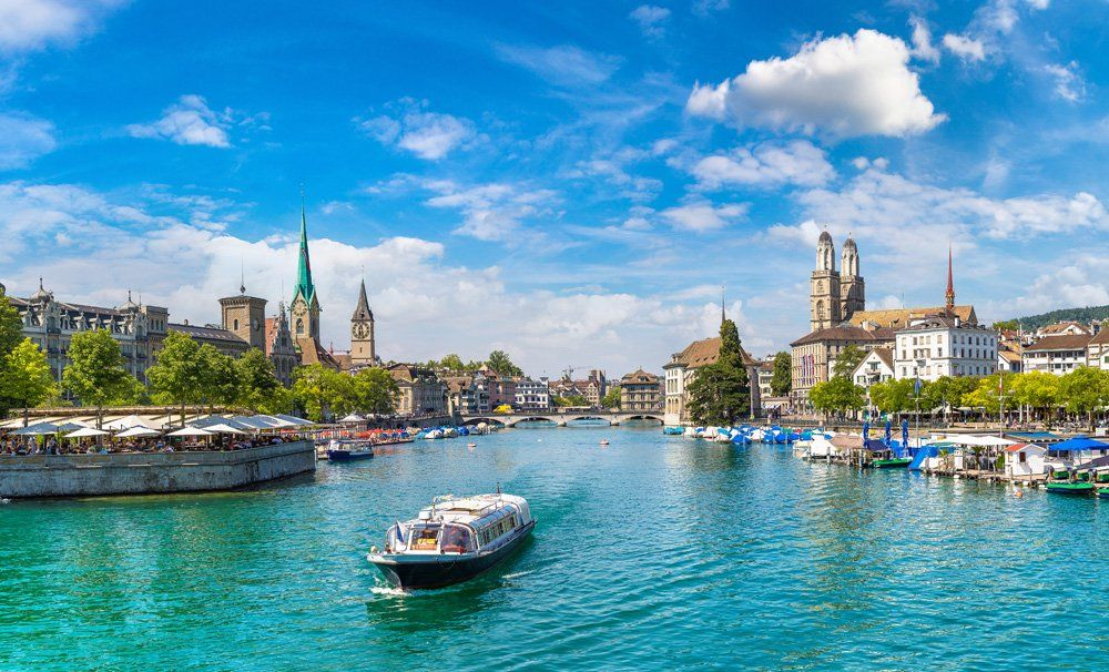 Historical part of Zurich with famous Fraumunster and Grossmunster churches on a beautiful summer day, Switzerland