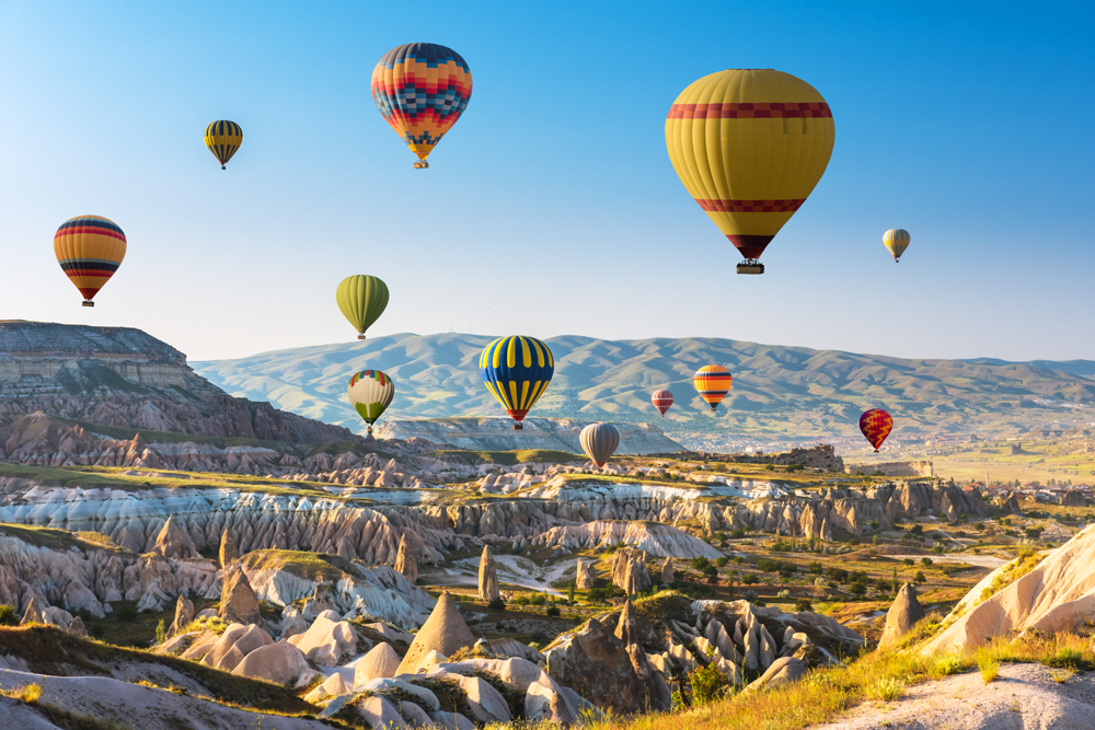 Hot air balloons in the sky at sunset, Cappadocia, Turkey