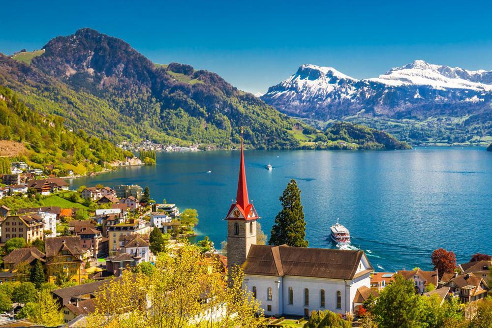 Lake Lucerne in Weggis village with Pilatus mountain and Swiss Alps in background, near Lucerne, Switzerland