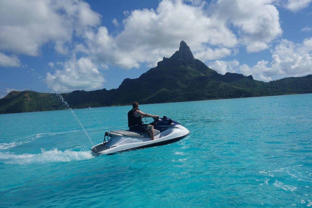 Man jet skiing in Bora Bora, Islands of Tahiti (French Polynesia)